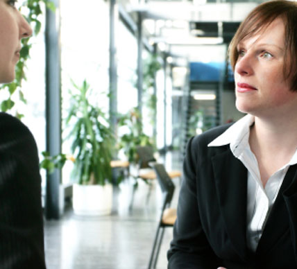 business woman talking with associate